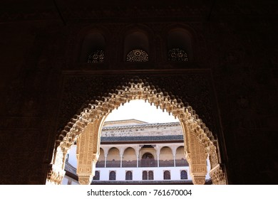 GRANADA, SPAIN - NOVEMBER 05, 2017: View inside the courtyard through the openwork moorish archways in Alhambra
