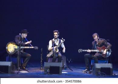GRANADA - SPAIN, NOVEMBER 7, 2015: Juan Perro trio at 36 Granada International jazz festival. Santiago Auseron, voice and guitar, Joan Vinyals, armonic guitar and Gabriel Amargant, saxophone.