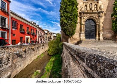 Granada, Spain October 17th, 2019. View on the Plaza de Santa Ana, Church of San Gil y Santa Ana and Darro River.