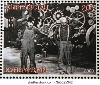 "GRANADA, SPAIN - OCTOBER 19, 2015: A stamp printed in Kyrgyzstan shows scene from the movie ""Modern Times"" by Charles Chaplin, circa 2000"