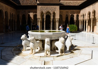 GRANADA, SPAIN - SEPTEMBER 23, 2018: The Court of the Lions in Alhambra palace in Granada in a beautiful day, Spain on September 23, 2018