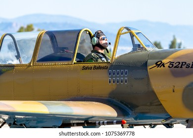 GRANADA, SPAIN-MAY 18: Airplane Yakovlev Yak-52 taking part in a exhibition on the X aniversary of the Patrulla Aspa of the airbase of Armilla on May 18, 2014, in Granada, Spain