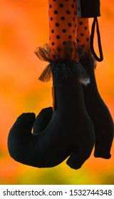 GRANBY QUEBEC CANADA 10 10 2019: Halloween time witch feet with orange background in downtown Bromont village eastern township.
