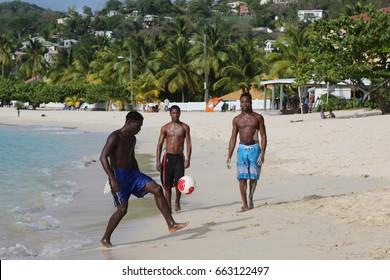 GRAND ANSE BEACH, GRENADA - JUNE 10, 2017: Local residents enjoy sunny day at Grand Anse Beach in Grenada.
