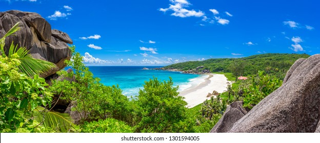 Grand Anse beach in La Digue island, view from granite boulder in Seychelles perfect white sand and clear azure water, panoramic view