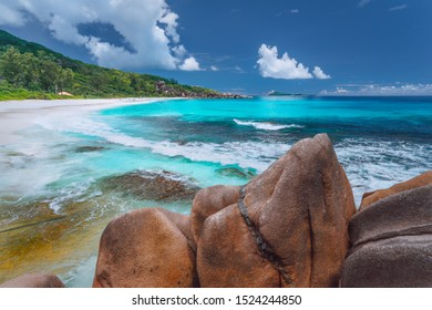 Grand Anse at La Digue island in Seychelles. Long exotic paradise like beach with blue lagoon and white waves