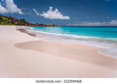 Grand Anse. Long sandy beach with turquoise blue ocean lagoon, La Digue island, Seychelles