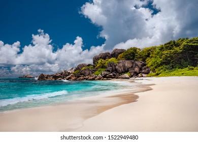 Grand anse sandy beach with azure ocean lagoon, La Digue island, Seychelles