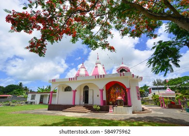 Grand Baie, Mauritius - Jan 10, 2017. A Hindu temple with flamboyant tree in Port Louis, Mauritius. According to the 2011, Hinduism is the major religion at 51.9 percent.