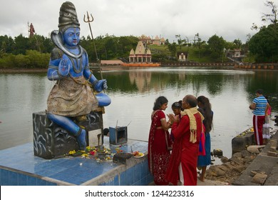 Grand Bassin, Mauritius - December 02, 2012: Unidentified people pray at Shiva statue at Ganga Talao (Grand Bassin) Hindu temple, Mauritius.