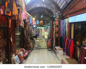 Grand Bazaar, Istanbul, Turkey - 31 July, 2018: Colorful stores and oriental textile products at the historical bazaar.