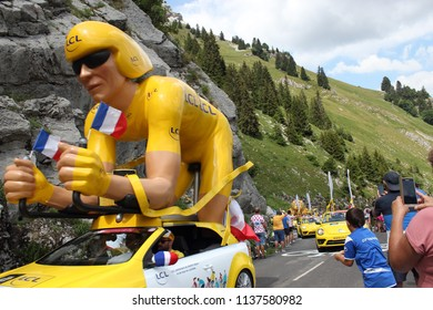 GRAND BORNAND, HAUTE SAVOIE / FRANCE JUILY 17 2018 : advertising car topped by a huge yellow cyclist of the LCL brand distributing free gifts to the public of the Tour de France