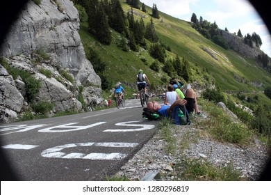 GRAND BORNAND, HAUTE SAVOIE / FRANCE JUILY 17 2018 :  on the road to col de la Colombiere in haute savoie, a spectator lay down on the road for the siesta while waiting for the tour de france 2018,
