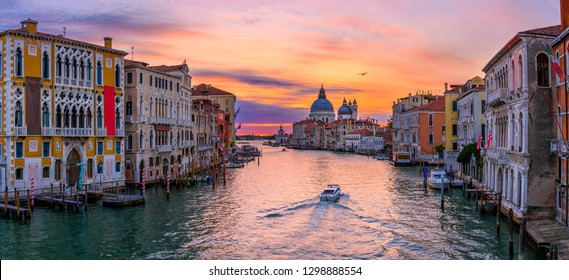 Grand Canal with Basilica di Santa Maria della Salute in Venice, Italy. Sunrise view of Venice Grand Canal. Architecture and landmarks of Venice. Venice panorama