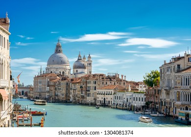 Grand Canal with Basilica di Santa Maria della Salute in Venice, Italy - 2018. View of Venice Grand Canal. Architecture and landmarks of Venice, Italy. Venice postcar. Summer sunny day.