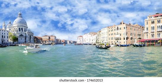 Grand Canal and Basilica Santa Maria della Salute with blue sky