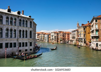 Grand Canal with gondoliers in Venice, Italy.