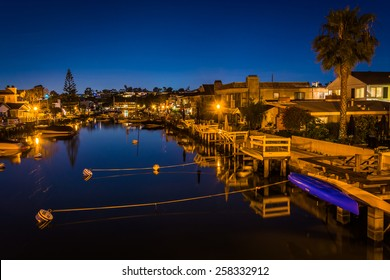 The Grand Canal at night, on Balboa Island, in Newport Beach, California.