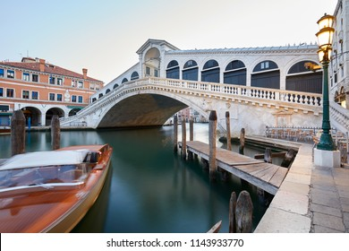 The Grand Canal and Rialto bridge in the early morning, nobody in Venice, Italy