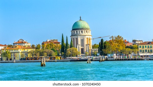 Grand Canal Tempio Votivo War Memorial Church Ferry Dock Restaurants Lido Venice Italy. Tempio Votivo was built between 1925 to 1935 for the War dead and last religious monument in the Venice Lagoon.