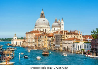 Grand Canal with tourist boats in summer, Venice, Italy. Romantic water trip in Venice. Historical buildings and cityscape of Venice. Beautiful scenic panorama of old Venice on a sunny day.