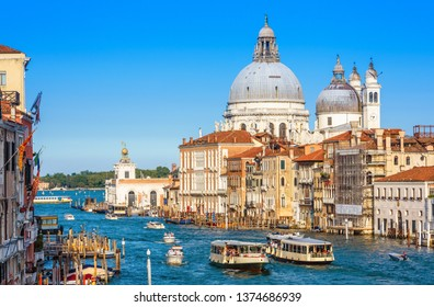 Grand Canal with tourist boats and vaporetto in summer, Venice, Italy. Romantic water trip in Venice. Ancient buildings and cityscape of Venice. Beautiful scenic panorama of the old Venice city.