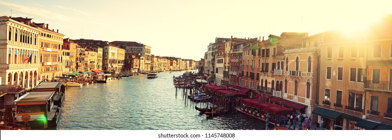 Grand Canal, Venice, Italy, called Canal Grande in Italian, as seen from Rialto Bridge. Beautiful view of sunset over the Venetian landmark river. Banner panorama background.