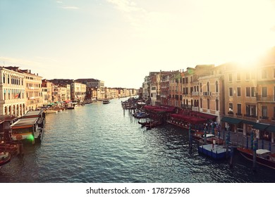 Grand Canal, Venice, Italy, called Canal Grande in Italian, as seen from Rialto Bridge. Beautiful view of sunset over the Venetian landmark river.