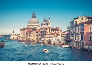 Grand Canal, Venice, Italy. It is one of the main tourist attractions in Venice. Nice panoramic view of the major street of Venice with motor boats. Romantic water trip across old Venice in summer.