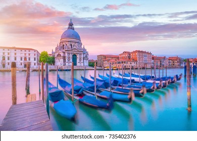 Grand Canal in Venice, Italy with Santa Maria della Salute Basilica in the background at twilight