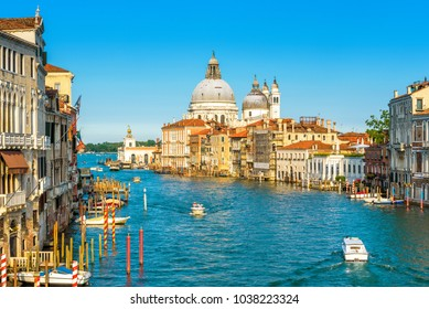 Grand Canal in Venice on a sunny day, Italy. Venice in the sunlight. Scenic panoramic view of Venice in summer. Cityscape and landscape of Venice. Romantic water trip in Venezia.