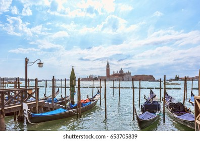 Grand canal in Venice, Piazza San Marco, in the background the island San Giorgio. Scenic moody cityscape with gondolas