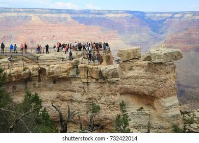 "Grand Canyon, Arizona, USA - September 11, 2017: Tourists at Mather Point, Grand Canyon. ""Grand Canyon"" was officially designated a national park on February 26, 1919"