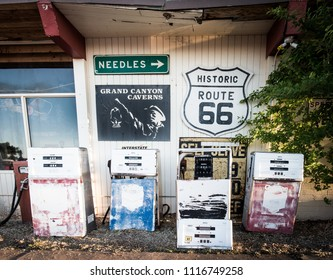 Grand Canyon Caverns and Inn, Route 66, Arizona, USA - May 15, 2018: Old Chevron gas filling stands and rustic signs collection in front of retro style motel at Route 66. Dinosaur caverns destination.
