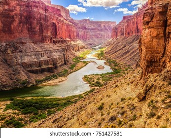 Grand Canyon Colorado River view and boats from Nankoweap Delta