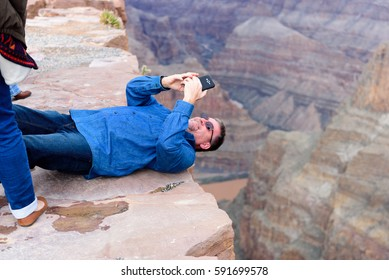 GRAND CANYON - February 19: Tourist Taking pictures at Eagle Point and Skywalk at Grand Canyon West Rim on February 19, 2017 in Grand Canyon, AZ