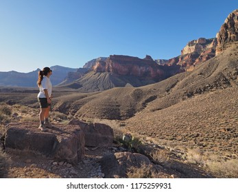 Grand Canyon National Park, Arizona - 05/19,2018: Young woman enjoys the view of the inner canyon from the Tonto Trail in Grand Canyon National Park, Arizona.