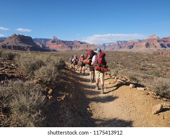 Grand Canyon National Park, Arizona - 05/18/2018: Backpackers hike along the Tonto Trail between Indian Garden and Horn Creek in Grand Canyon National Park.