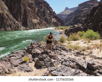 Grand Canyon National Park, Arizona - o5/20/2018: Young woman explores Granite Rapids and surrounding area during a backpacking expedition in the canyon.