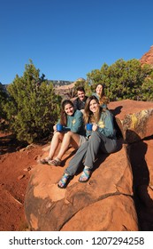 Grand Canyon National Park, Arizona - 05/24/2016: Family of backpackers rest on a rock on Horseshoe Mesa in Grand Canyon National Park, Arizona.