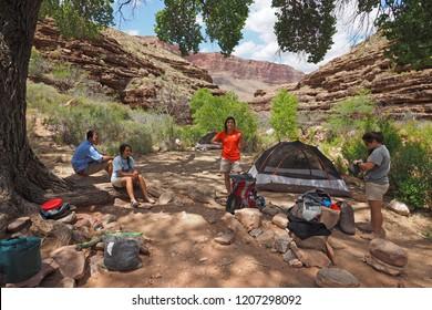 Grand Canyon National Park, Arizona - 05/24/2016: Young backpackers in camp at Hance Creek in Grand Canyon National Park, Arizona.