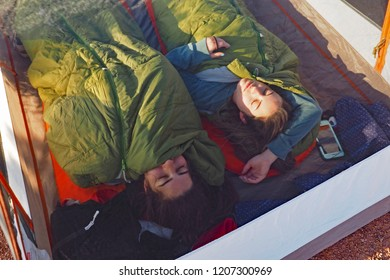 Grand Canyon National Park, Arizona - 05/24/2016: Two young women sleep in their tent on Horseshoe Mesa in Grand Canyon N ational Park, Arizona.