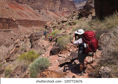 Grand Canyon National Park, Arizona - 05/25/2016: Backpackers on the Tonto Trail on a family vacation in the Grand Canyon.