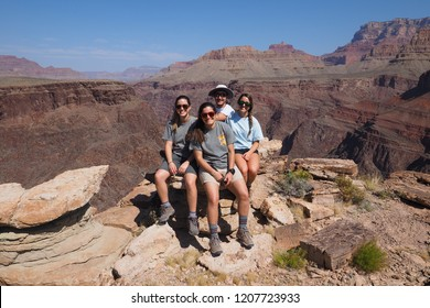 Grand Canyon National Park, Arizona - 05/25/2016: Young backpackers rest on the Tonto Trail while backpacking in the Grand Canyon during a family adventure vacation.