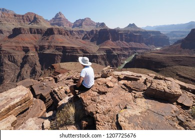 Grand Canyon National Park, Arizona - 05/25/2016: Young male backpacker enjoys the view from the Tonto Trail on a multi-day hike in the Grand Canyon.
