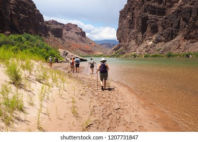 Grand Canyon National Park, Arizona - 05/26/2016: Family hikes alongside the Colorado River just above Hance Rapids in the Grand Canyon on a family adventure vacation