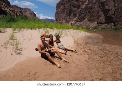 Grand Canyon National Park, Arizona - 05/26/2016: Young backpackers rest on a beach on the Colorado River during a multi-day hike in the Grand Canyon on a family adventure vacation.