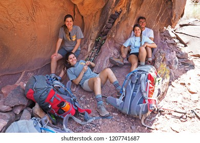 Grand Canyon National Park, Arizona - 05/25/2016: Young backpackers rest in the shade on the Tonto Trail during a multi-day hike in the Grand Canyon.