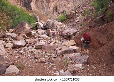 Grand Canyon National Park, Arizona - 05/26/2016: Backpackers ascend the very strenuous New Hance Trail in Grand Canyon National Park.