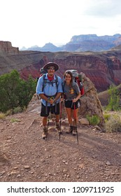 Grand Canyon National Park, Arizona - 05/26/2016: Young couple pause while ascending the very strenuous New Hance Trail in Grand Canyon National Park.